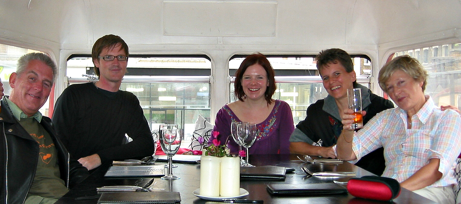 "George D Rodger (L), in London's Rootmaster ""bustaurant"" with long-term Vegan Society members Dean Bracher, Caroline McAleese, Lee Hall, and Patricia Tricker. Are those Virginian Stock flowers on the table?"